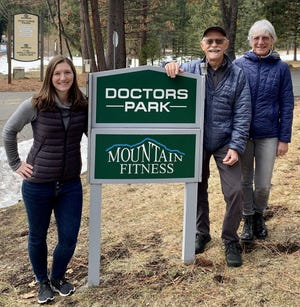 Hannah Durbin-Defebvre of Weed stands with her parents, Scott Durbin and Neva Barnett, in front of the sign for her new practice in Mount Shasta at Doctor's Park.
