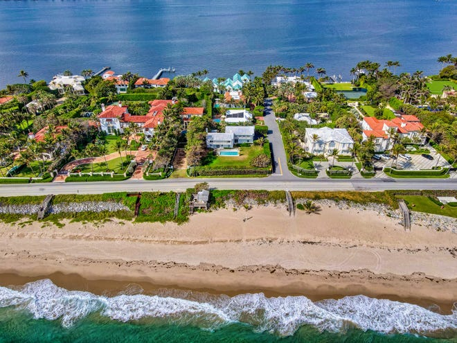 With a pool in its front yard, a 1950s-era beachfront house in Palm Beach at 1540 S. Ocean Blvd., center, has sold at land value for recorded $10.5 million on the stretch of coastal road known to locals as Billionaires Row. A cabana parcel on the beach changed hands as part of the transaction.
