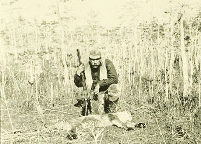 Charles Barney Cory is photographed on a hunting expedition in Florida.