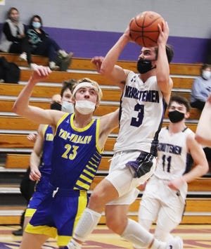Lexington's Ben Peacock goes up for a shot against Tri-Valley defender TJ Norman during Tuesday's Heart of Illinois Conference basketball game at The Fort. Peacock had a game-high 24 points while Norman led Tri-Valley with 18 points in a 50-45 Vikings' victory.