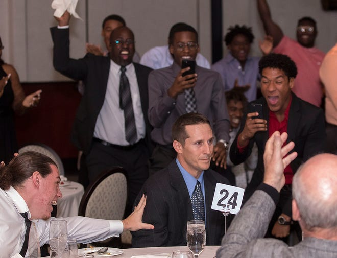 Forest Hill High School students go wild after their coach Jude Blessington (center seated) was named the 2017 coach of the year during the Lou Groza Awards banquet at the Kravis Center, December 4, 2017.