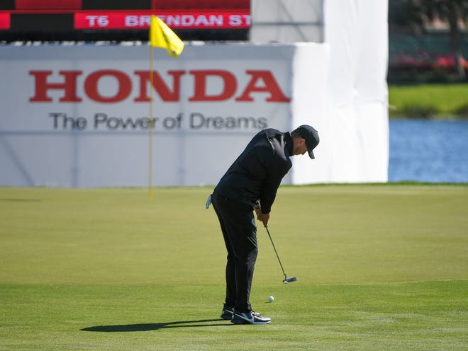 Brooks Koepka hits a long eagle putt on the 18th green during the second round of the 2020 Honda Classic at PGA National in Palm Beach Gardens. [JEFF ROMANCE/SPECIAL TO THE POST]