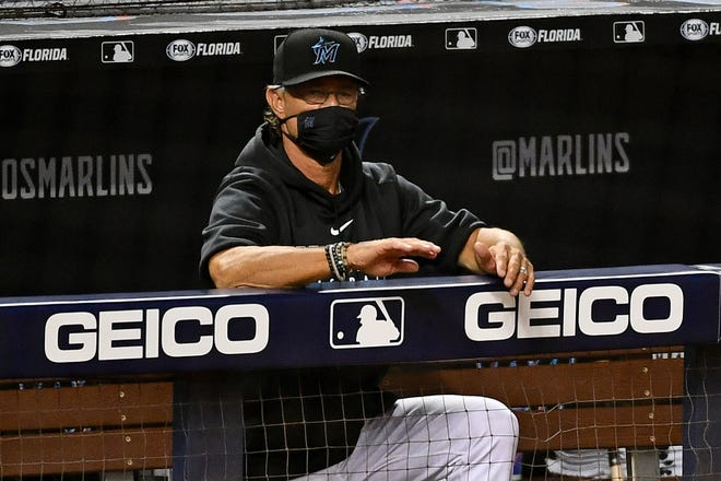 Marlins manager Don Mattingly (8) watches the from the dugout during a game against the New York Mets at Marlins Park last season. [Jasen Vinlove-USA TODAY Sports]