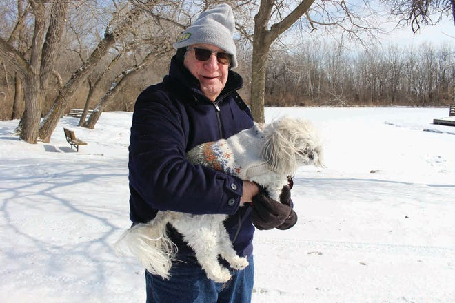 Bundled up against the cold, Pratt resident Mike McFall walks his dog, Teddy, at Lemon Park on Monday. Early Monday morning temperatures dipped to -12F with wind chill warnings in the -20 to -30 degree range in Pratt. Tueday temps were similar.