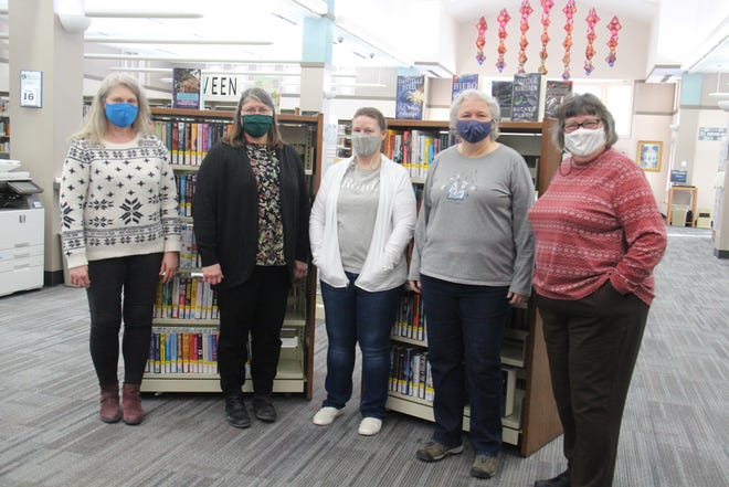 Perry Public Library staff members include, from left, Jill Cook, Mary Murphy, Misty Von Behren, Beth Schmidt and Suzanne Kestel. The library is reopening to the public on Wednesday, Feb. 17.
