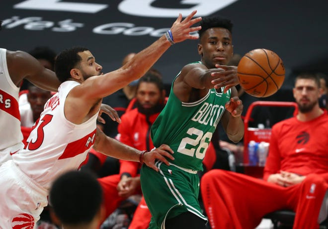 Celtics forward Aaron Nesmith, right, passes the ball against Raptors guard Fred VanVleet during a Jan. 4 game. Nesmith has been working his way into the Boston rotation as of late, including Tuesday's win over Denver.