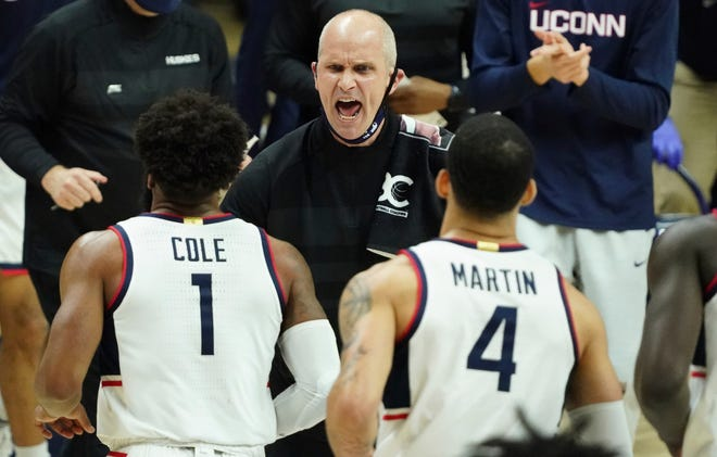 UConn head coach Dan Hurley talks to his team during the game on Feb. 16 against Providence. The Huskies — who were original members of the Big East — returned to the conference this season after several years in the American Athletic Conference.