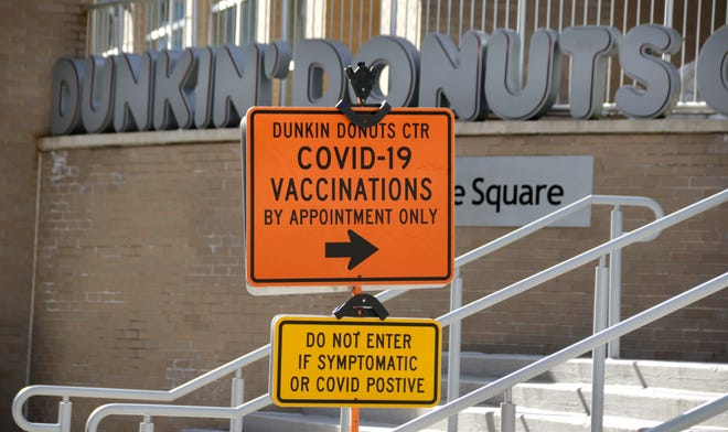 Signs posted outside the Dunkin' Donuts Center in Providence on Wednesday in preparation for Thursday's vaccine clinic.