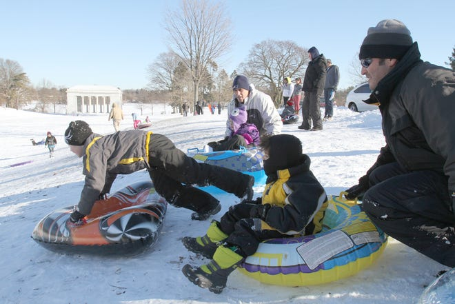 Families enjoy some sledding at Roger Williams Park, one of the state's most popular places to go for a slide.