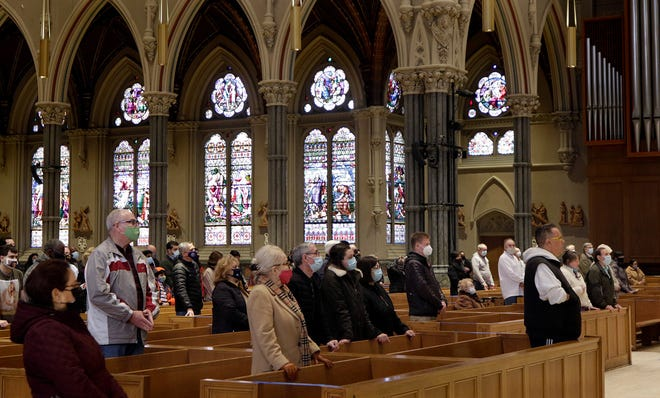 Worshippers at Ash Wednesday Mass at the Cathedral of Saints Peter and Paul, in Providence.