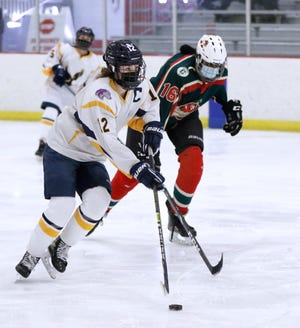 In her final season, East Bay's Katherine Barker (left) earned yet another honor as part of the Providence Journal First-Team All State Girls Hockey Team.