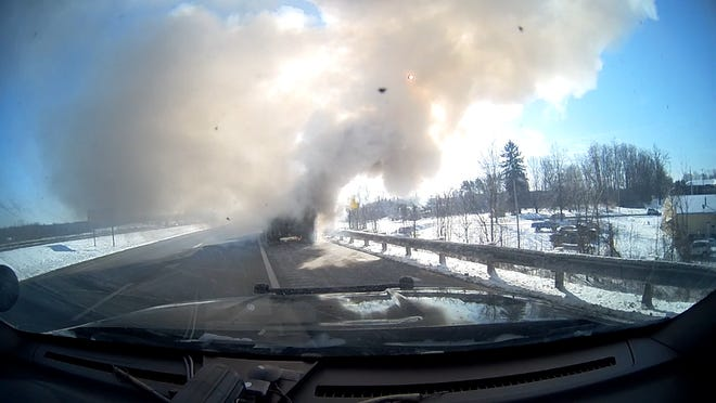 This photo taken by a Streetsboro police cruiser dash camera shows the rear of a truck on fire on Interstate 480 eastbound on Wednesday morning. The highway was briefly shut down due to the fire. No injuries were reported.