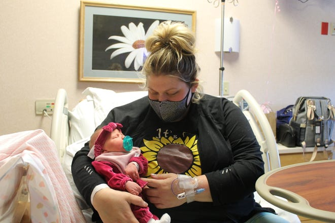 Stevie Arnold, of Massillon, holds her baby, Paisley Rickett, who was born Tuesday at Aultman Hospital.