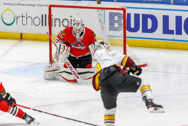Goalie Matt Tomkins makes this save against the Chicago Wolves on Tuesday, Feb. 16, 2021, but he couldn't help Rockford get into the win column for the first time this year.