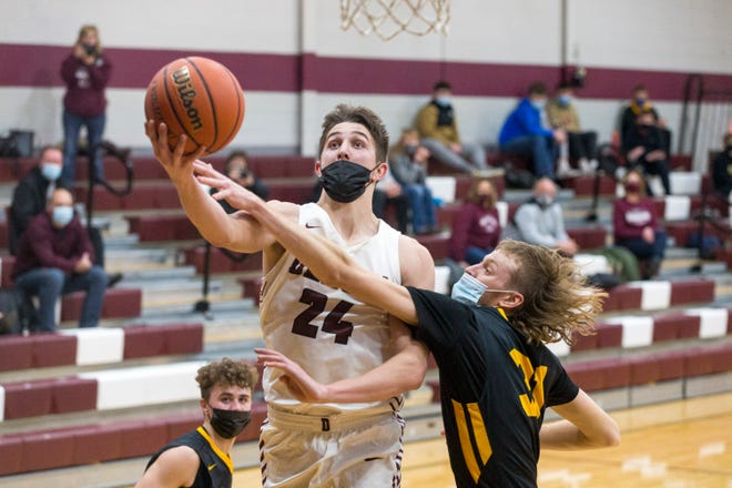 Dakota's Caden Moyer gets the basket and gets fouled by Le-Win's Caleb Matz in the third quarter of their game at Dakota Junior Senior High School on Tuesday, Feb. 16, 2021, in Dakota.
