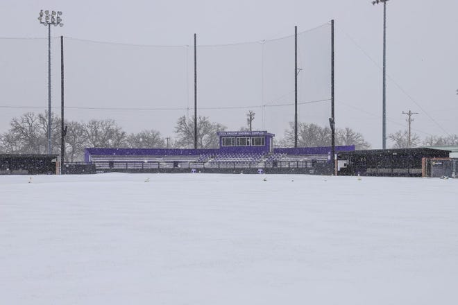 Tarleton's Cecil Ballow Baseball Complex is covered in snow from this week's winter storm. The inclement weather forced the Texans to move their Division I inaugural game to Saturday against Abilene Christian in Abilene.