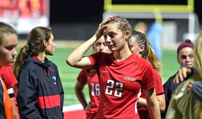 Cardinal Mooney girls soccer players react after a tough loss to Tampa Berkeley Prep in a Class 3A-Region 2 quarterfinal match Tuesday night at John Heath Field at Austin Smithers Stadium in Sarasota.