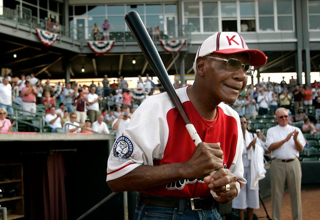 Buck O'Neil walks to the field as he is introduced before a minor league all-star game July 18, 2006, in Kansas City, Kan.