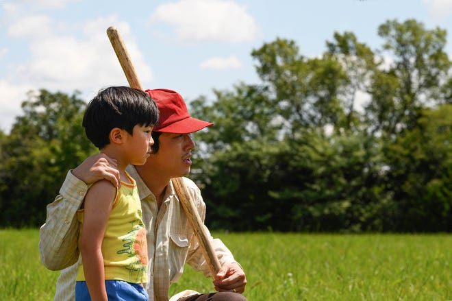 "Steven Yeun, right, appears in ""Minari"" with Alan Kim."