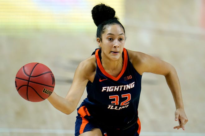 Illinois guard Aaliyah Nye passes the ball to a teammate against Maryland on Wednesday, Feb. 17, 2021, in College Park, Md. [Julio Cortez/The Associated Press]
