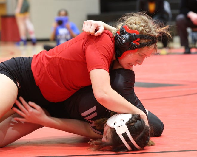 A foreign exchange student from Denmark, Emporia's Hannah Boa (top) had to Google wrestling to know anything about the sport before arriving in the United States. But she's surprised herself and others how successful she's been in her first year, posting a 22-4 record.
