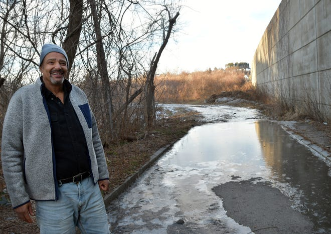Retired probation officer, Carl Gomes, trying to spruce up his neighborhood and revive the idea of a park at 149 West Boylston Drive.