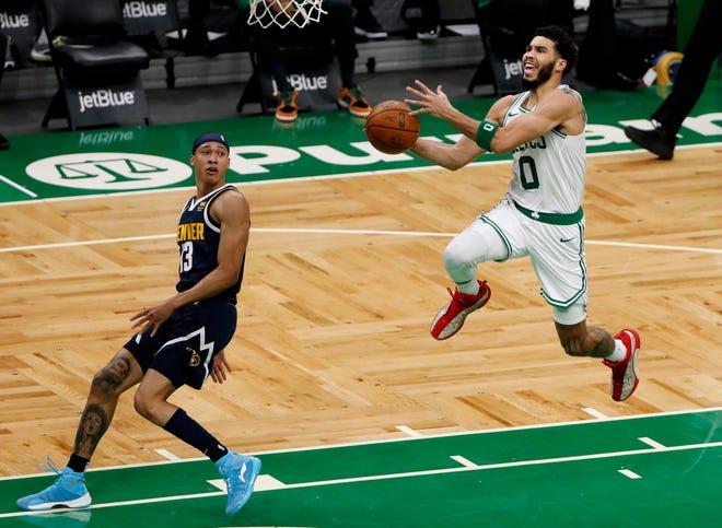 Celtics forward Jayson Tatum drives to the basket against Nuggets guard R.J. Hampton during Tuesday night's first quarter.