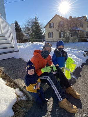 Butch Blanchard, a city sanitation worker, met 4-year-old Landon Guidetti, right, and 18-month-old Miles Guidetti on his route Wednesday. Landon made Blanchard's day with a special thank you note he wrote about two weeks ago.