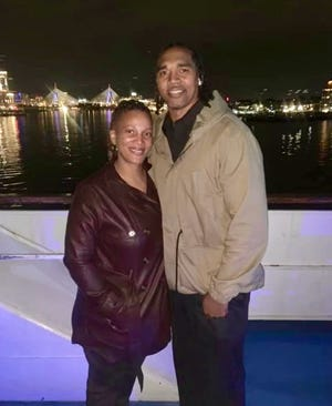 Sacha and DeMarr Langford, who both starred in basketball at Worcester State, enjoy an evening by the water.