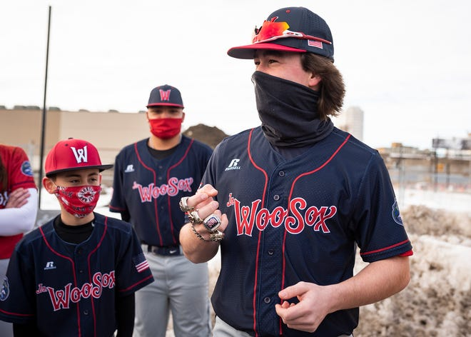 Seth Larson, 17, tries on the World Series rings of Dr. Charles Steinberg as they announce the Junior WooSox program during an event Wednesday outside Polar Park.