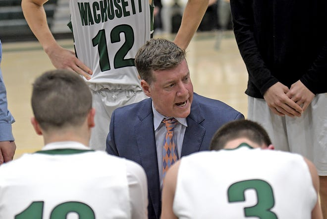 Wachusett boys' basketball coach Tom Gibbons, shown addressing his players during a game last season, is close to notching his 300th career victory.