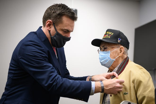 Rep. Richard Hudson pins a Bronze Star onto Ormand Strickland, a 95-year-old World War II veteran, on Wednesday, Feb. 17, 2021, at Fayetteville Fire Station #14.