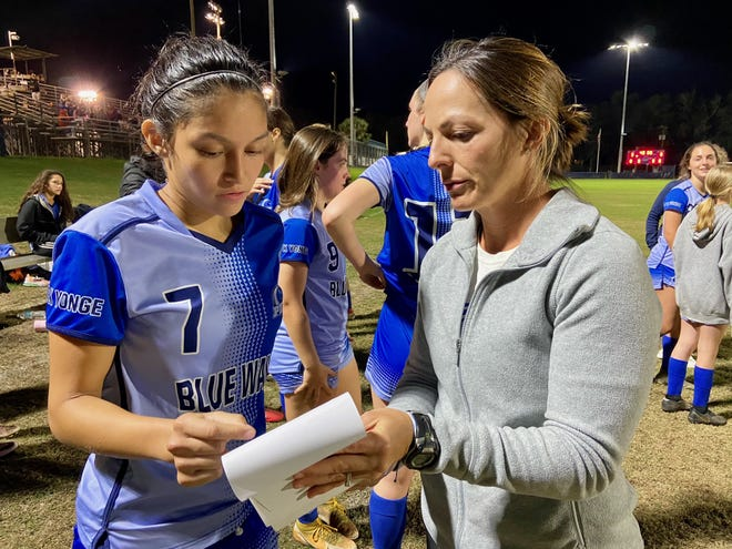 P.K. Yonge girls soccer coach Rebecca Schackow and senior Juliette Palechor discuss strategy during halftime of Tuesday night's Class 3A regional quarterfinal playoff game. The Blue Wave won 5-0 to advance to the regional semifinal.