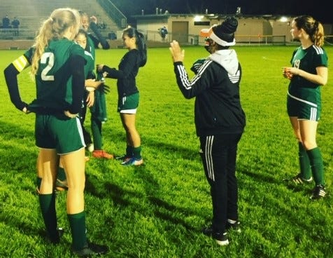 First-year Eastside girls soccer coach Terrie Ellerbe talks to her team following a 6-0 first-round playoff loss Tuesday to Titusville at Citizens Field.
