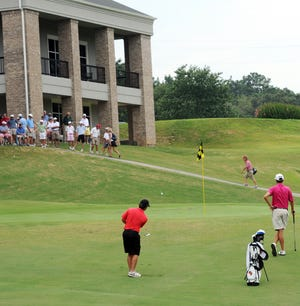 The clubhouse at the Gadsden Country Club is shown during a past State Amateur Golf Championship. Honours Golf of Birmingham, a division of Troon, has taken over all management activities at the 102-year-old club.