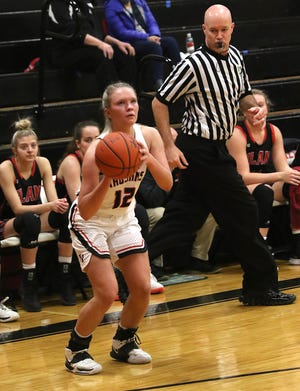 Tusky Valley's Arora Levengood eyes a 3-point shot in the game with Hiland earlier in the season.