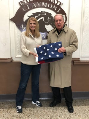 Jim Carrothers of Stephenson, Stephenson and Carrothers law firm recently presented a new heavy duty flag to Claymont Intermediate School Principal Beth DiDonato. She said the flag will proudly fly outside the school for many years to come.