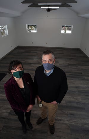 Melissa Wilde, Violet Township trustee, and Michael Kaper, executive director of Fairfield County Land Bank, stand in the outbuilding at the Wigwam campus that recently was renovated by the township with the help of a grant from the Fairfield County Land Bank. Wilde also is on the board of directors for the nonprofit corporation.