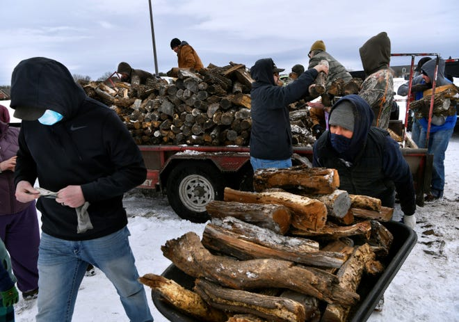 Abilene residents converged on the former Lack's furniture story parking lot at the corner Buffalo Gap and Antilley roads Tuesday afternoon to get firewood brought by Silvano Alvarez. With a prolonged loss of power, many residents with fireplaces were able to get some heat. Cost was $250 a cord.
