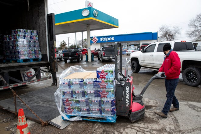 A pallet of water is unloaded from a truck at a Stripes gas station on Leopard Street in the Calallen area on Wednesday, Feb. 17, 2021.