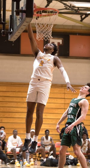 Camden's Jerome Brewer puts up a shot above Camden Catholic's Colin Merriman during the boys basketball game played at Woodrow Wilson High School in Camden on Tuesday, February 16, 2021.  Camden defeated Camden Catholic, 84-59.