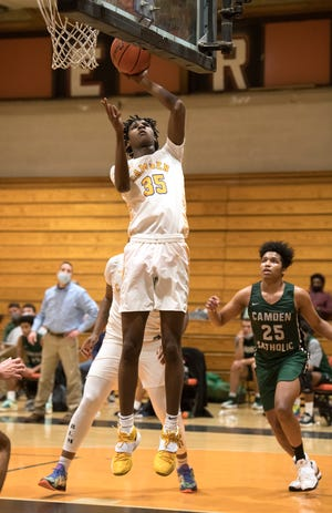 Camden's Dasear Haskins puts up a shot during the boys basketball game between Camden and Camden Catholic played at Woodrow Wilson High School in Camden on Tuesday, February 16, 2021.  Camden defeated Camden Catholic, 84-59.