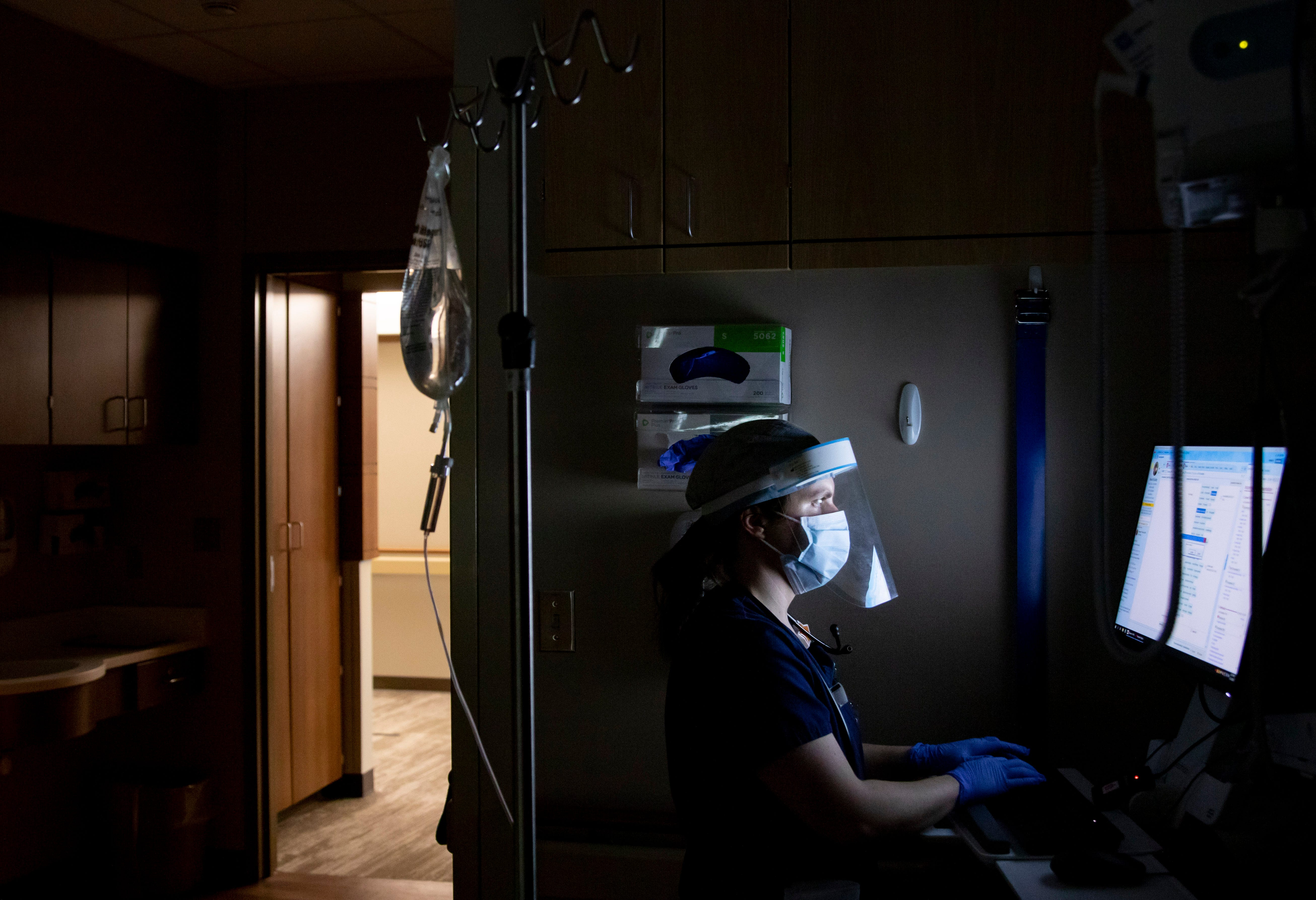 Nurse Amanda Baetsle enters information into a patient's chart at Mary Greeley Medical Center in Ames on Feb. 12, 2021.