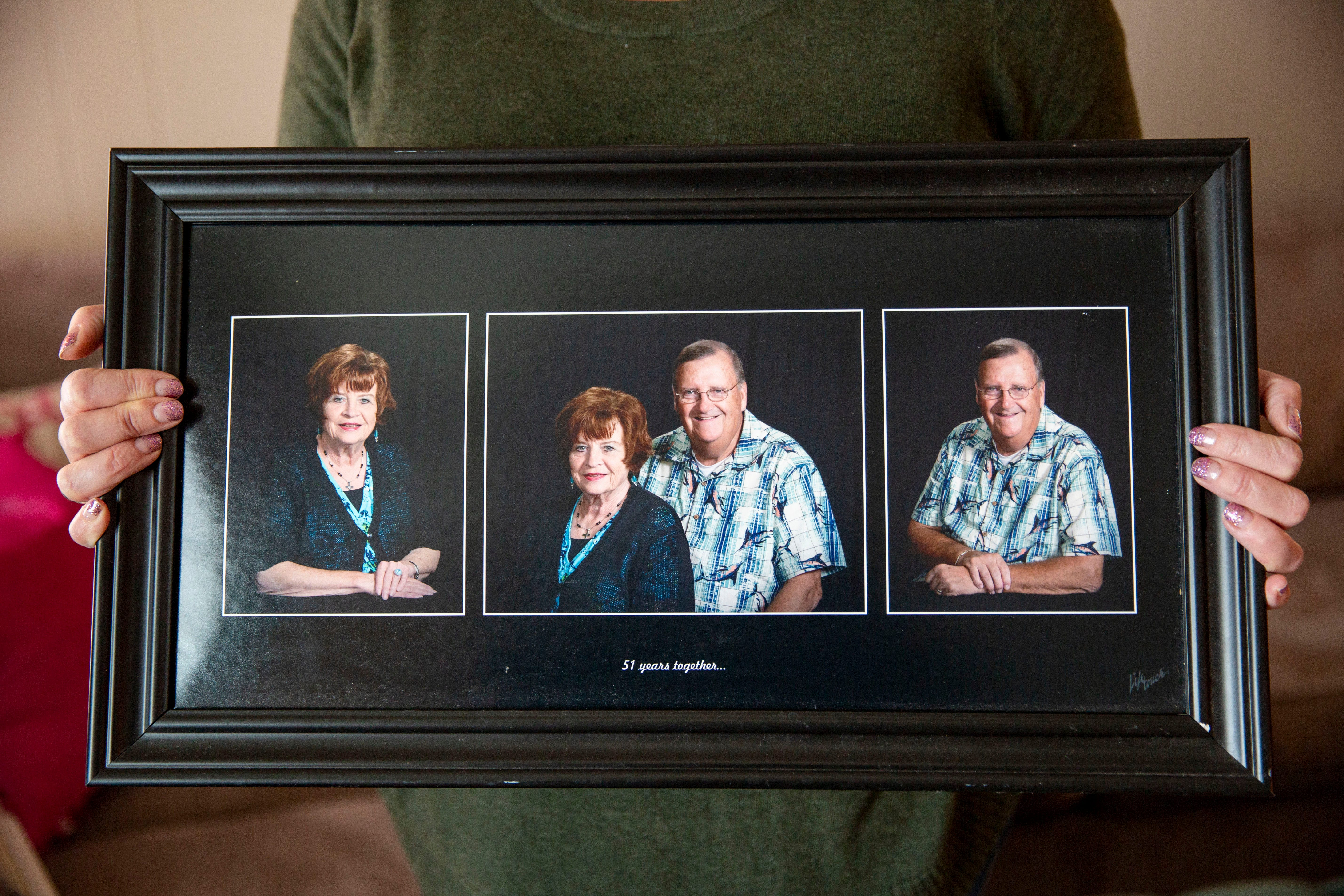 Suzanne Winkelpleck holds a photo of her parents, Lou and Patty Luiken, at her home in Dysart on Feb. 11, 2021.