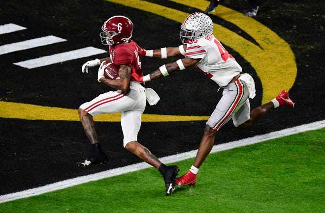 Alabama receiver DeVonta Smith scores a touchdown during the national championship game. An Ohio lawmaker wants to create a University of Alabama license plate.
