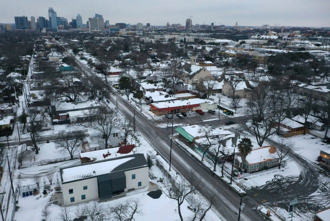 Snow and ice grips a neighborhood in East Austin on Tuesday.