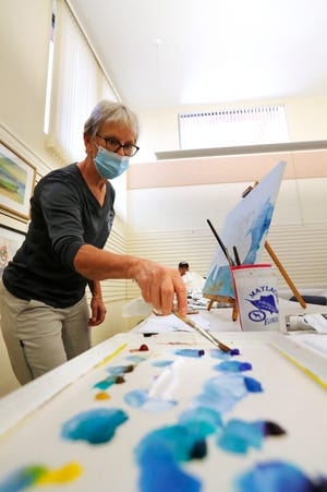 Beth Blewett uses acrylics to paint while participating in an open class at the Cape Coral Art League last month.