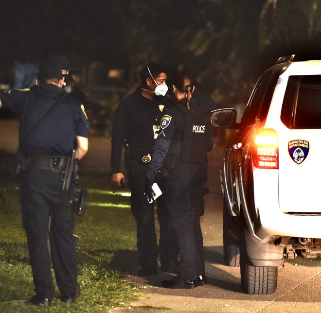Guam Police Department officers investigate the scene of a shooting on San Francisco Street in Agat, Feb. 16, 2021.