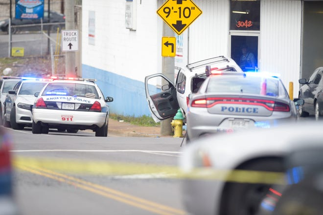 The victim's vehicle is seen crashed on the curb the scene of a shooting on Central St. and Atlantic Ave. in Knoxville, Tenn. on Wednesday, Feb. 17, 2021. At least one person was reported injured.