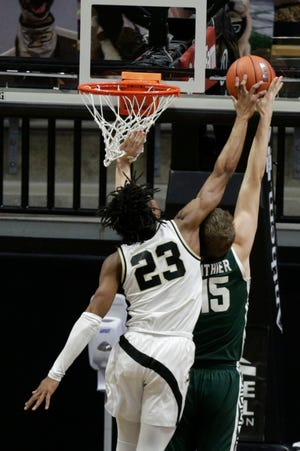 Purdue guard Jaden Ivey (23) blocks Michigan State forward Thomas Kithier (15) from behind during the second half of an NCAA men's basketball game, Tuesday, Feb. 16, 2021 at Mackey Arena in West Lafayette.